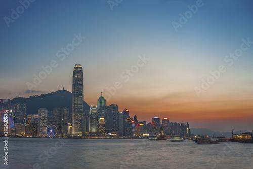 Victoria Harbor of Hong Kong city at dusk Poster