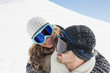 Close up of a couple in ski goggles against snow