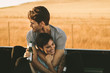 canvas print picture - Couple enjoying on a road trip in their pick up truck