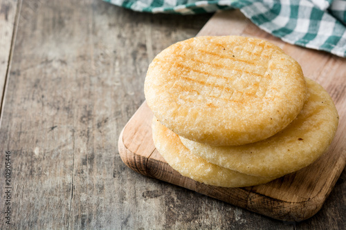 Arepas on wooden table. Venezuelan typical food