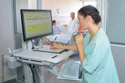 Fotografie, Obraz  writing the patient's details