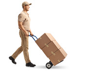 Delivery Guy Pushing A Hand Truck With Boxes