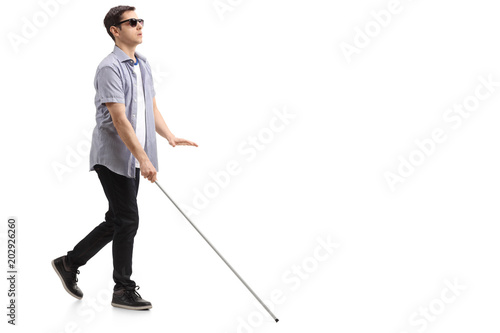 Fotografie, Tablou Blind young man with a cane walking