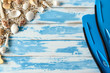 Beach accessories on vintage blue wooden board. Summer vacation concept.