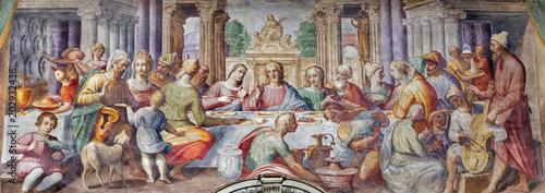 Fotografia PARMA, ITALY - APRIL 16, 2018: The fresco of The wedding at Cana in church Chiesa di Santa Croce by Giovanni Maria Conti della Camera (1614 - 1670)