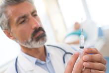 Doctor Preparing Needle