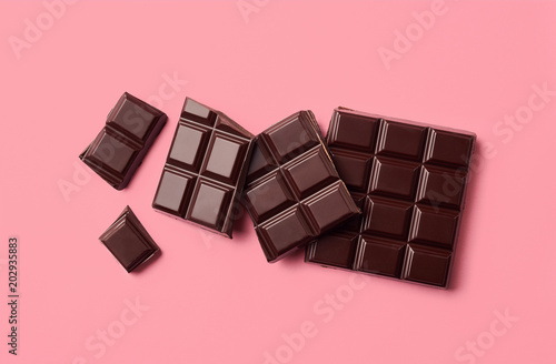 Dark chocolate on pink background