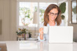 canvas print picture - Middle age woman using computer and drinking coffee, indoor