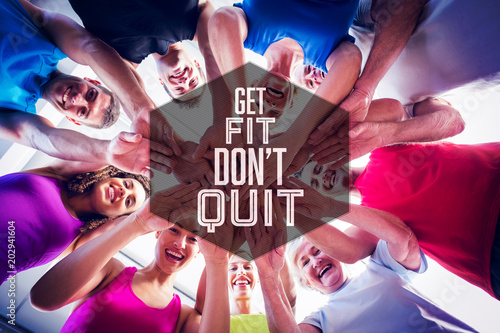 Motivational new years message against people stacking hands at health club Poster