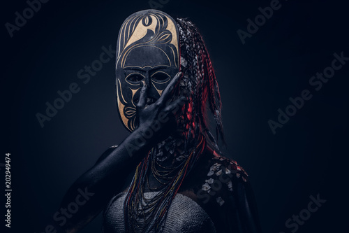 Canvas Print Close-up portrait of a witch from the indigenous African tribe, wearing traditional costume