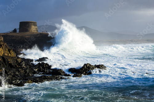 Foto op Plexiglas Canarische Eilanden wave breaking on the coast, Fuerteventura Canary Islands