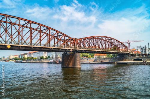 Photo  Old iron railway bridge over the Vltava river
