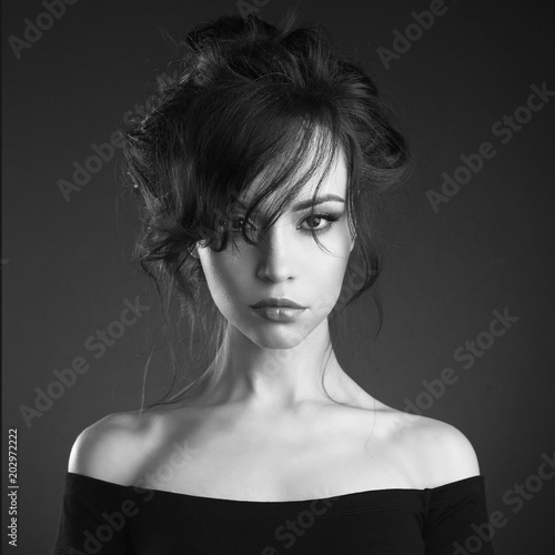 Tuinposter womenART Beautiful woman with elegant hairstyle on black background