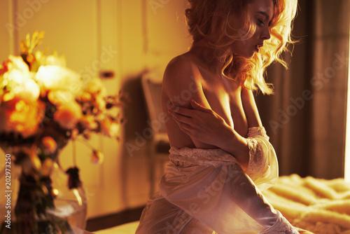 Fotografie, Obraz  Sensual blonde in her boudoir
