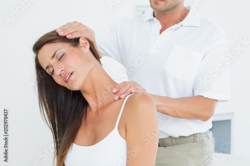 Male chiropractor doing neck adjustment Canvas Print
