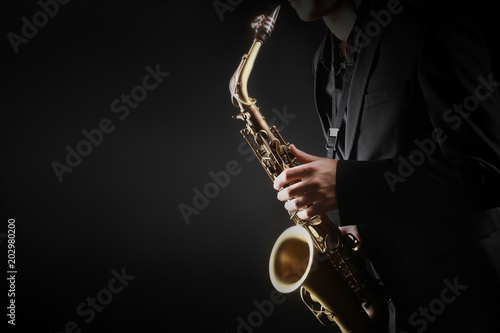 Fotoposter Muziek Saxophone player. Saxophonist hands playing saxophone