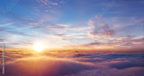 Beautiful sunset sky above clouds