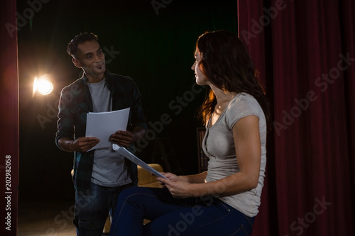 Fotografie, Tablou  Artists discussing with each other on stage