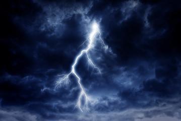 A lightning strike on a cloudy dramatic stormy sky.