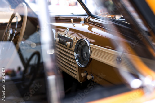 Keuken foto achterwand Vintage cars Interior view of classic vintage car. Beautiful retro car, interior elements, chrome and wood, the concept of expensive collector cars, premium class
