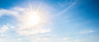 Leinwandbild Motiv Sunny background, blue sky with white clouds and sun