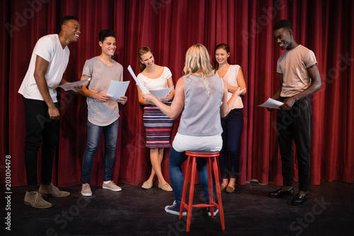 Photo Actors reading their scripts on stage