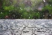 Rain Drop Falling Onto Blackboard With Green Nature Background