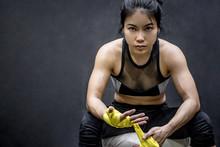 Asian Female Boxer Wearing Yel...