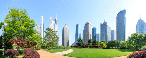Obraz city park with modern commercial building background in shanghai - fototapety do salonu
