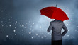 canvas print picture - Businessman standing while holding red umbrella over the networking connection and storm in city huge rain background. Business crisis and business leader concept, being different concepts