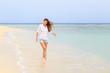 Young woman in white shirt enjoying summer vacation.