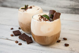 Iced Mocha Coffee with Whip Cream, Summer Drinking times. Coffee Beans. rustic textured Wooden Background. Mint Leaves