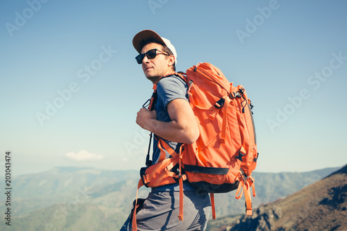 Portrait of backpacker posing in the mountains Canvas Print