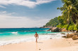 young man at the beach during vacation at the tropical islands of the Seychelles