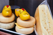 Dutch Cheese And Traditional Wooden Shoes Clogs In The Shop Window