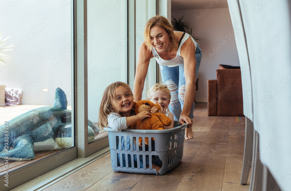 Fototapety, obrazy: Mother playing with her children at home