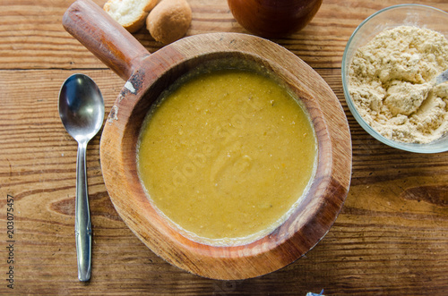 Photo Stands Ready meals Watercress soup in wooden bowl and rustic table