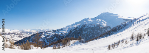 Panoramic view of Sestriere ski resort from above, famous travel destinatio in the Alps, Piedmont, Italy. #203076086