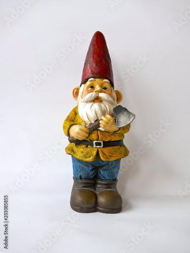 Fotografie, Obraz  Gartenzwerg mit rotem Hut, gelber Jacke, blauer Hose und brauner Stiefeln
