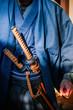 A man in Samurai costume with Katana sword