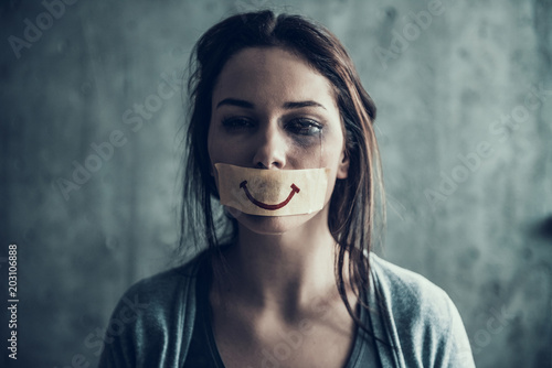Photo  Oppressed beaten woman cries.