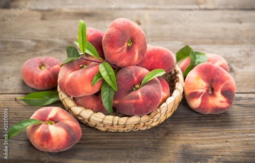 Fresh saturn peaches in the basket