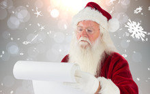 Santa Claus Checking His List Against Grey Design With Snowflakes