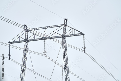 Electricity pylons against sky at day