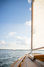 Sailboat Sailing On Sea Against Cloudy Sky