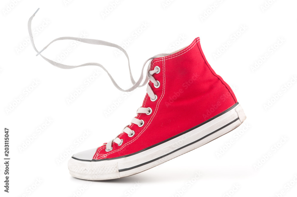 Fototapeta Single red sneaker on white background
