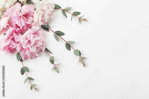 Fotobehang Bloemen Bunch of beautiful flowers and eucalyptus leaves on white table top view. Flat lay style.