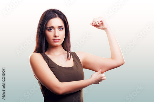 Woman pinching flabby fat arm skin Canvas Print