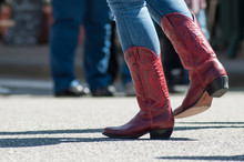 Closeup Of Woman Legs With Red American Boots At Country Show In Outdoor