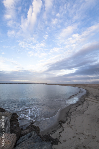 Staande foto Strand High angle view of scenic beach against blue cloudy sky